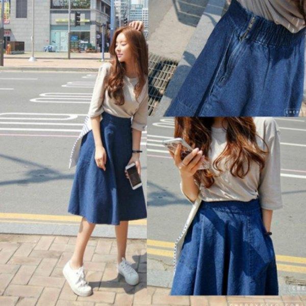 blush pink half sleeve tee with blue unwashed flared denim skirt