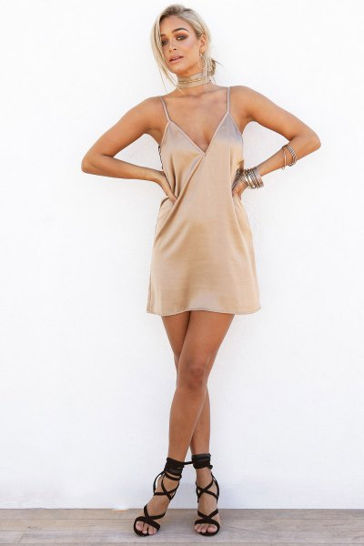 blush pink mini silk slip dress with black strappy heels