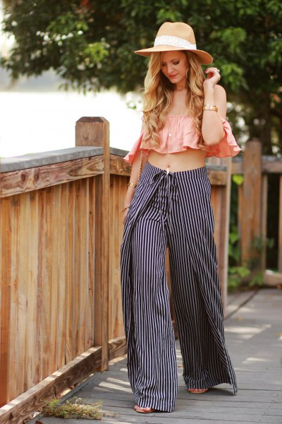 blush pink sleeveless ruffle crop top with black and white striped pants