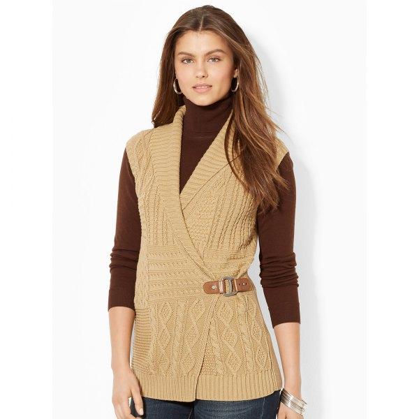 blush pink sleeveless shawl collar sweater over black turtleneck top