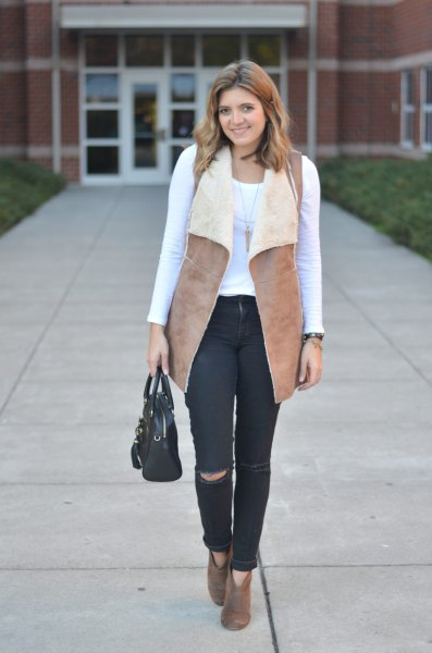 49898ab2cc478 Camel Shearling Vest with White Long Sleeve Tee   Black Jeans