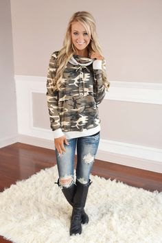 camo cowl neck hoodie with ripped jeans and black leather knee high boots