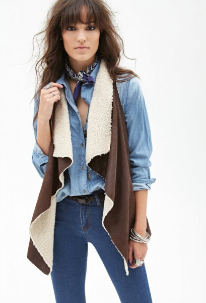 chambray shirt with brown shearling vest skinny jeans