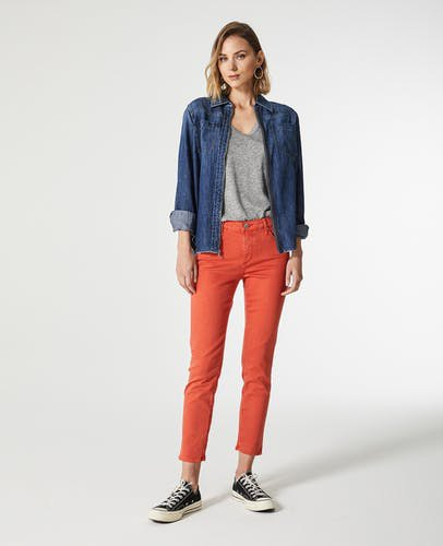 dark blue denim jacket with orange skinny ankle pants