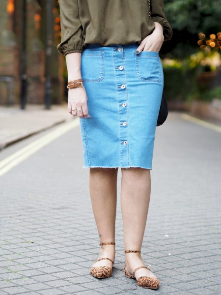green buttonless blouse with blue denim button front knee length skirt