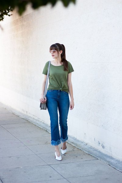 green knotted t shirt with flared fringe hem jeans