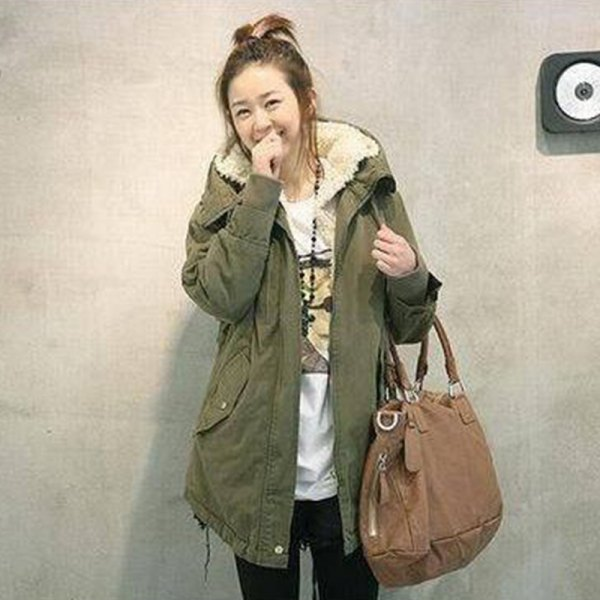 green long parka coat with white print tee