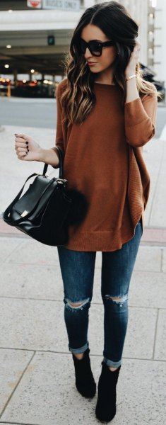 green long sweater with ripped skinny jeans and suede boots