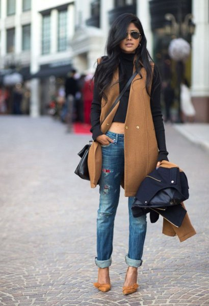green sleeveless trench coat with black turtleneck cropped sweater