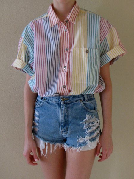grey and white striped button up shirt with ripped denim shorts
