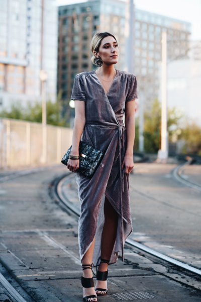 grey high low maxi dress with black clutch bag