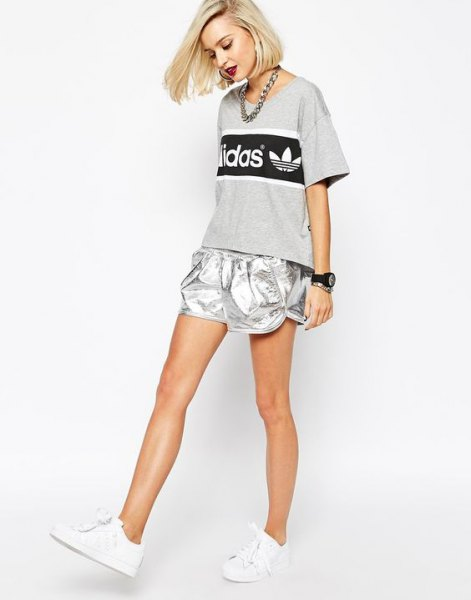 grey print tee with silver running shorts and white sneakers