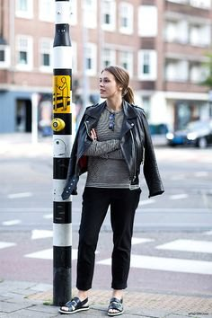 grey relaxed fit sweater and black leather jacket