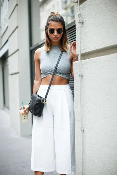 grey sleeveless crop top with white cropped pants