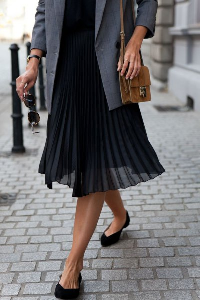 grey suit jacket with sweater and black pleated midi chiffon skirt
