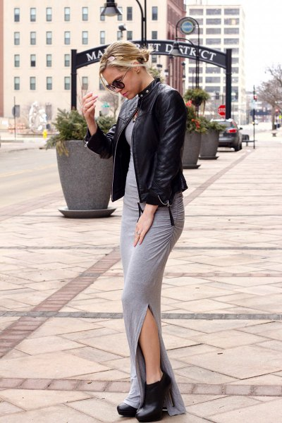 heeled black boots with leather jacket and grey maxi bodycon dress