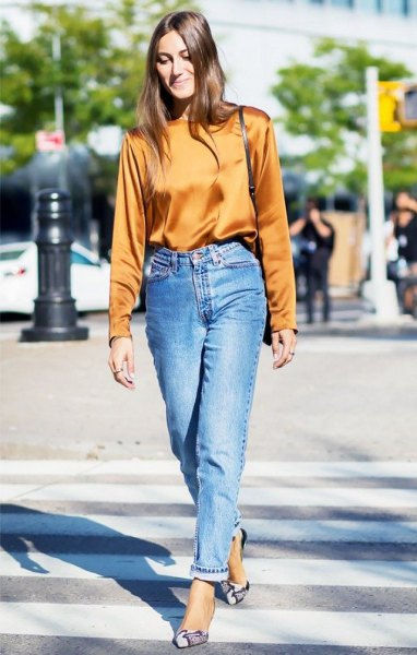 lime green silk sweater with high waisted blue jeans