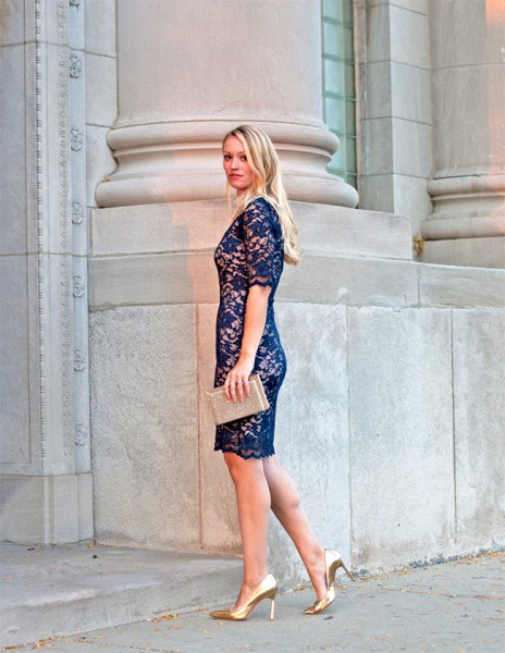 navy lace dress with pale pink clutch bag