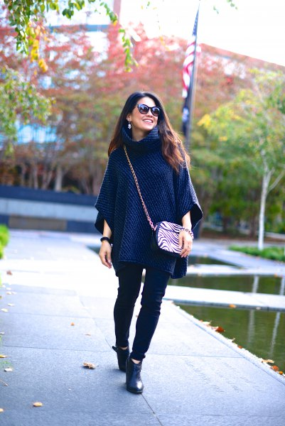 navy poncho sweater with black skinny jeans
