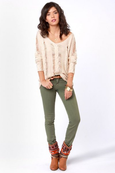 pale pink ripped long sleeve top with olive green skinny jeans