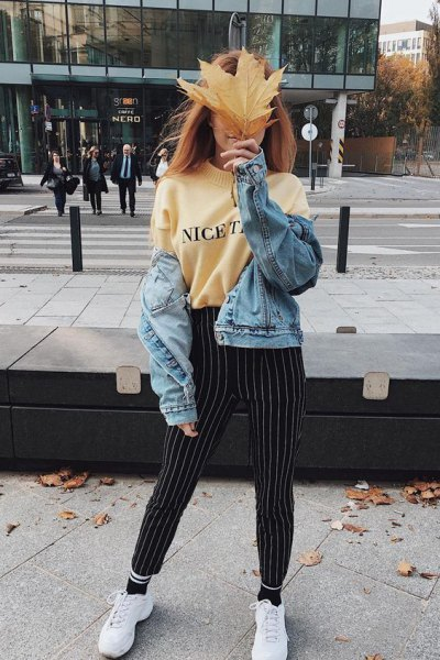 pale yellow printed sweatshirt with black and white striped pants