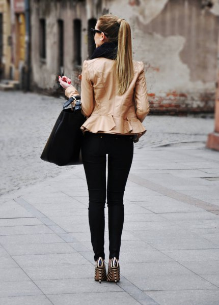 pink peplum jacket with black skinny jeans
