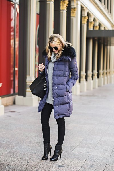 purple long puffer coat with grey sweater and black skinny jeans