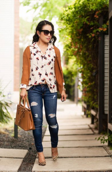red cardigan with white floral blouse