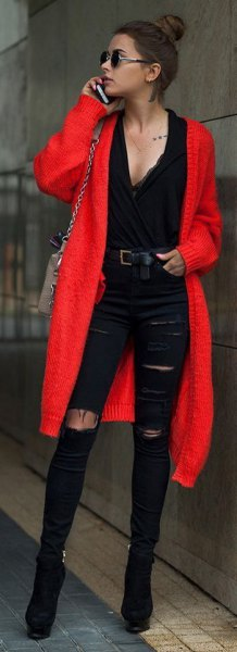 red midi cardigan with black deep v neck blouse and ripped jeans