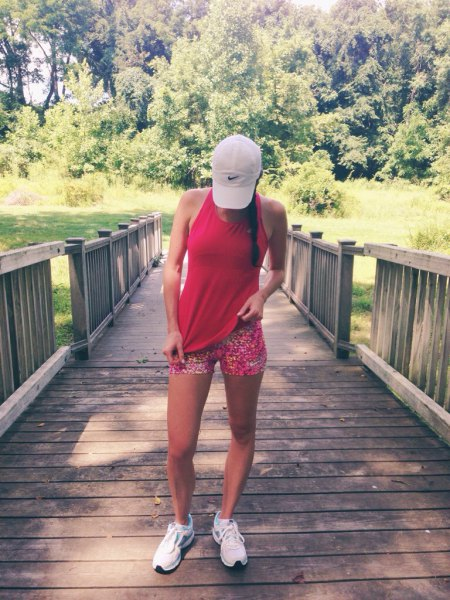 red vest top with rainbow color printed running shorts