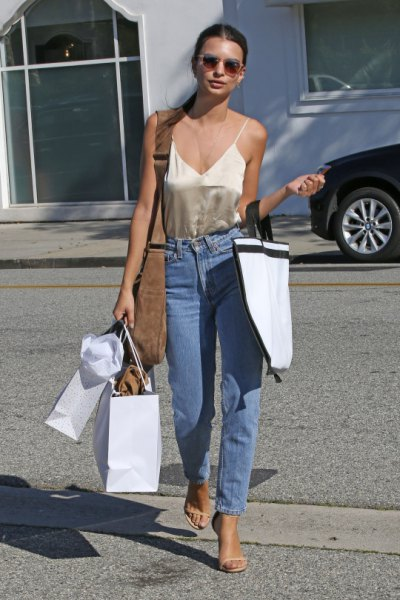 rose gold camisole with high waisted blue jeans