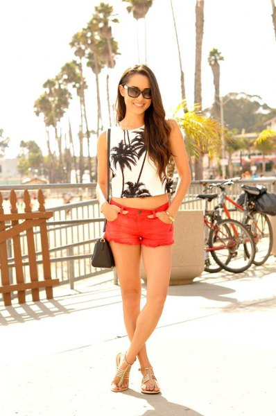 white and black printed crop top with orange mini shorts