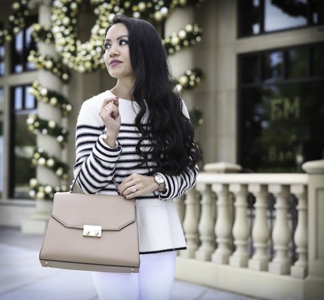 white and black striped peplum sweater with pink leather purse