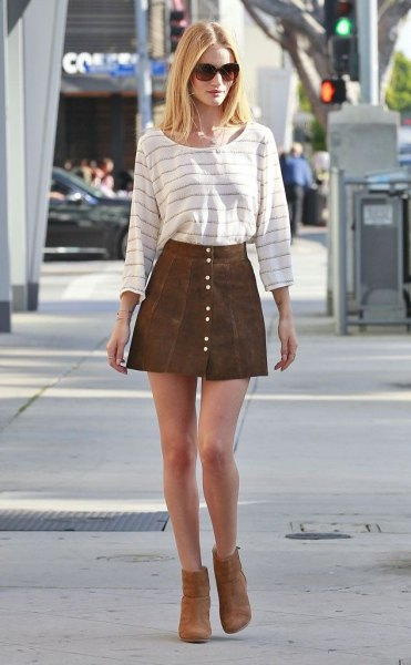 white and grey striped tee with mini button front suede skirt