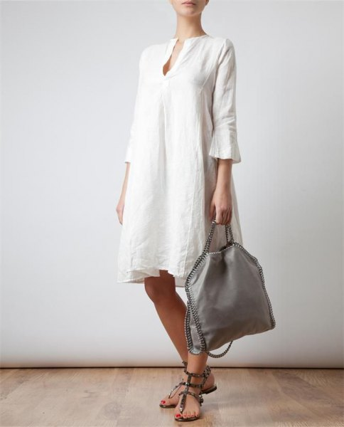 white bell sleeve linen knee length dress with sandals