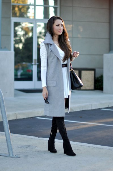 white belted mini dress with grey sleeveless long jacket