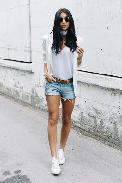 white blazer with blue ripped mini denim shorts