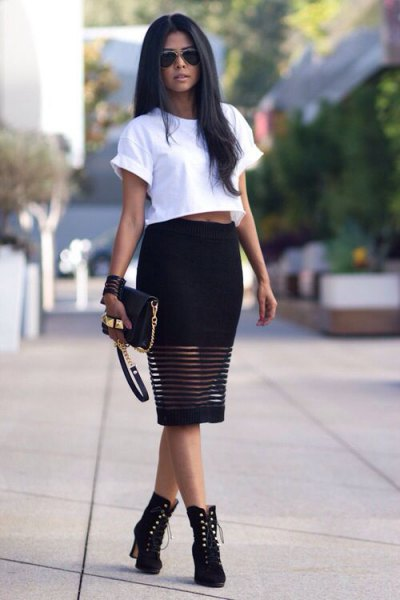 white cropped t shirt with black midi dress and boots