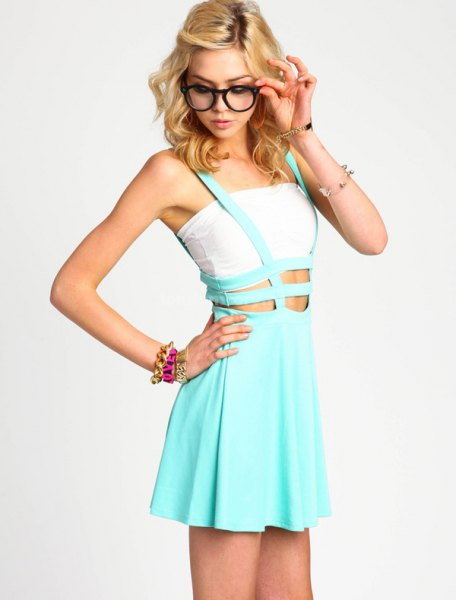 white cropped tube top with sky blue strappy suspender dress