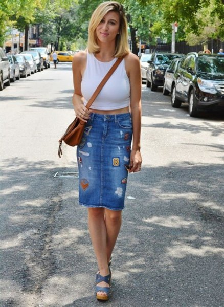 white cropped vest top with blue high waisted knee length denim skirt