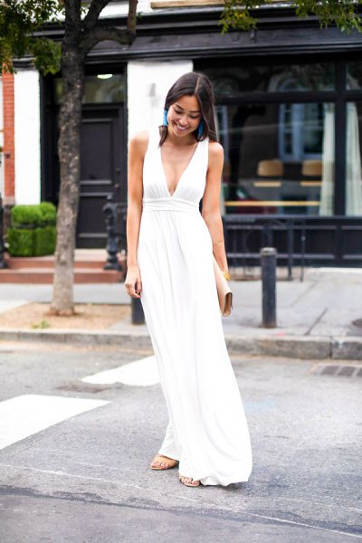 white deep v neck gathered waist maxi dress with silver heels