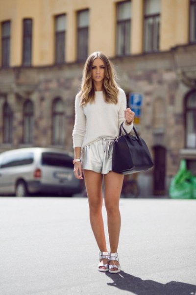 white fitted knit sweater with silver metallic shorts