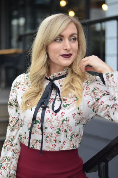 white floral blouse with black ribbon bow