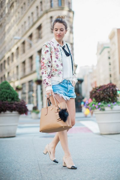 white floral bomber jacket with blue mini denim shorts