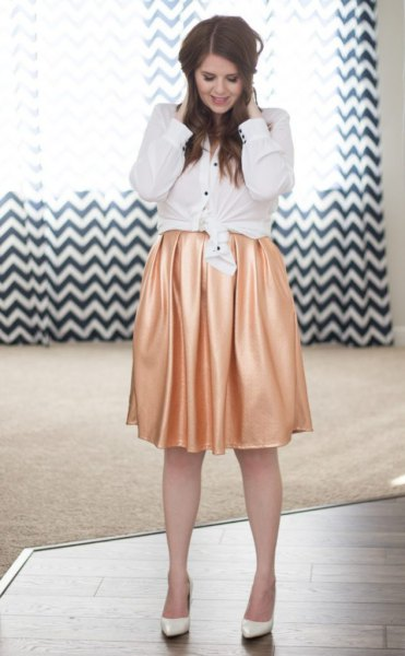 white knotted button up shirt with pink silk pleated skirt