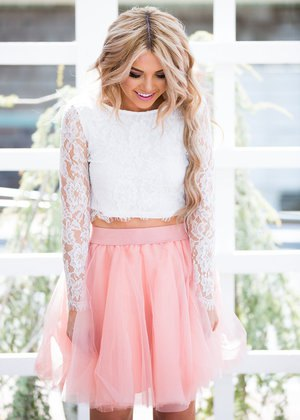 white lace long sleeve cropped blouse with blush pink tulle mini skirt