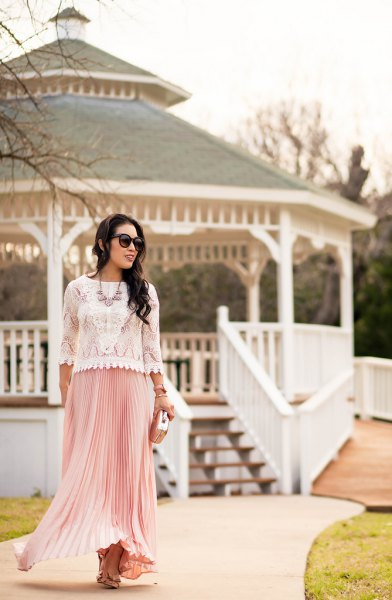 white lace scalloped hem sweater with pink pleated maxi skirt