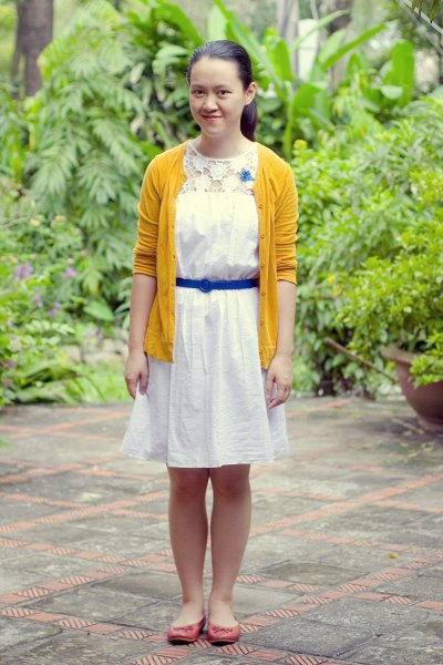white linen belted shirt dress with yellow cardigan