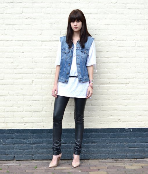 white long oversized tee with blue denim sleeveless jacket