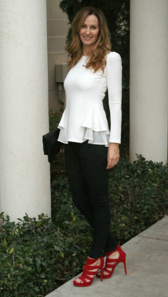 white long sleeve peplum top with black chinos and red heels
